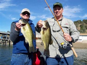 Ken Poole on the left. Doug Kulick on the right and two caught and released clear Lake Bass. Note the bamboo spinning rod as well