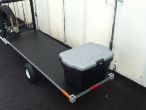 bicycle trailer showing optional solid bed with rod rack and stowage box