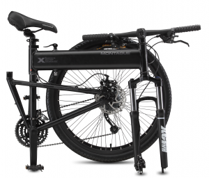 The bike folded, sits in the co-pilot seat within the folded bike storage bag.