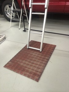 rubber shop rug which keeps your ladder in place on hard surfaces